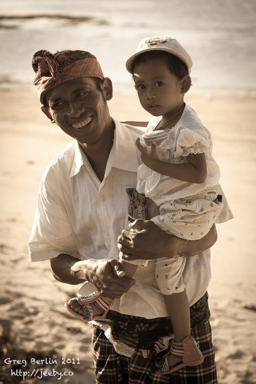Man & his son on the beach at Sekotong, Lombok, Indonesia