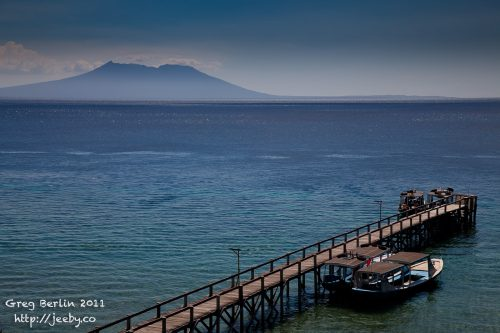 Menjangan Island jetty with Java in the background, Bali, Indonesia