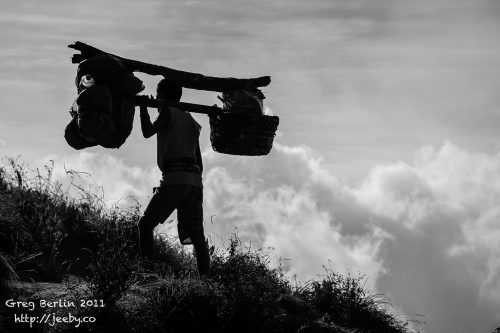 Porter and the clouds, Gunung Rinjani, Lombok, Indonesia