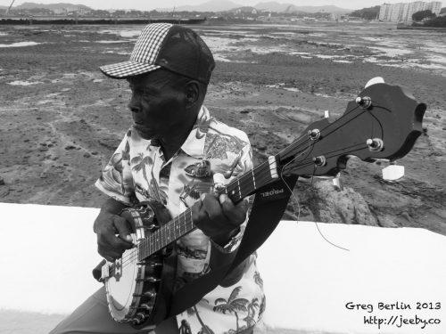 Man playing a banjo in Panama City