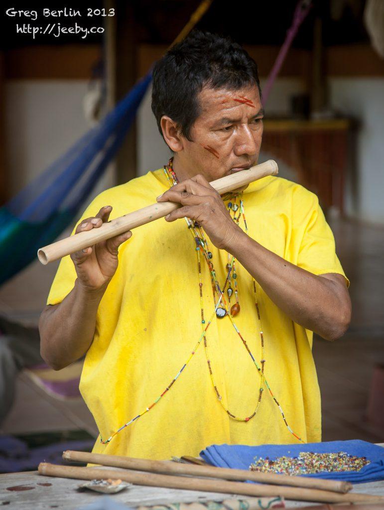 A Siekopai Elder tweaks his newly made flute at Guaria de Osa, Costa Rica