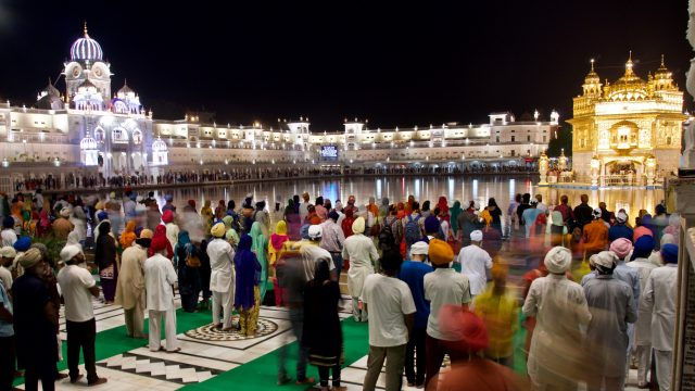 Nighttime Crowd At The Golden Temple